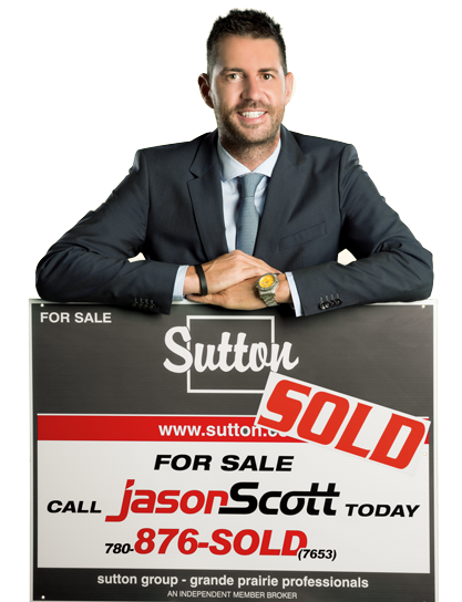Jason Scott with Sold Sign